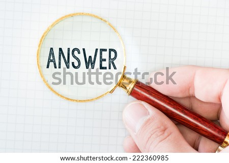 "Person with magnifying glass and word ""Answer"" - stock photo"