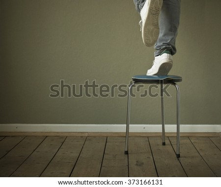 Person One Leg On Chair Danger Stock Photo (Royalty Free) 373166131 ...