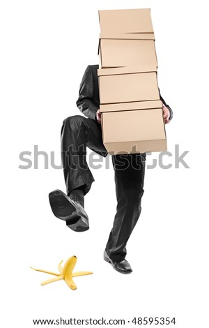 Person with paper boxes about to step on a banana peel