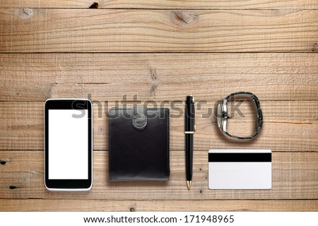 Personal accessories on wooden background - stock photo