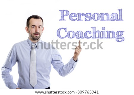 Personal Coaching - Young businessman with small beard pointing up in blue shirt - stock photo