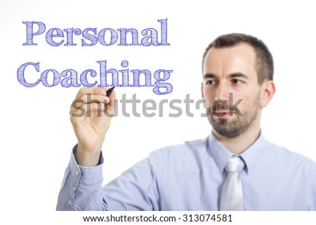 Personal Coaching - Young businessman writing blue text on transparent surface - stock photo