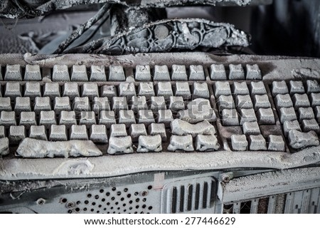 Personal computer burnt due to electricity short circuit - Threat to computer hardware concept - stock photo