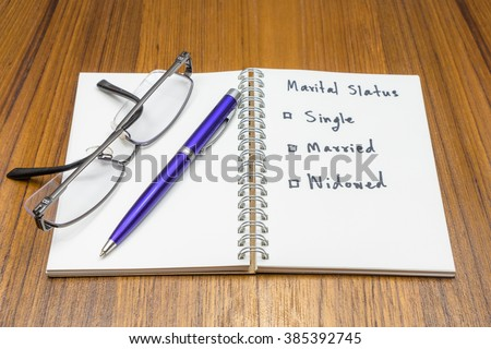 Personal Data (Marital Status) on wood background