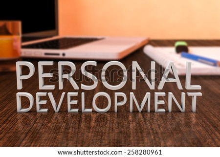 Personal Development - letters on wooden desk with laptop computer and a notebook. 3d render illustration. - stock photo