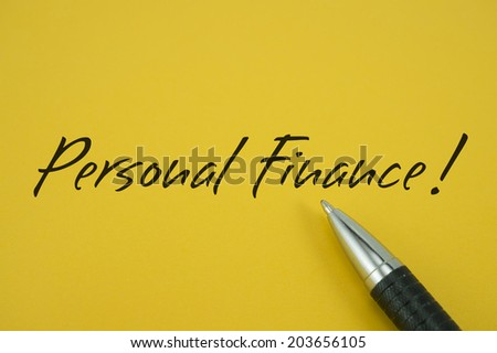 Personal Finance! note with pen on yellow background - stock photo