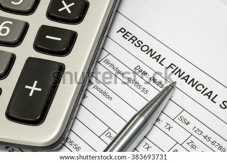 Personal financial statement document, calculator and pen