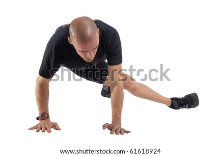 Personal fitness trainer (coach) exercising over white background - stock photo