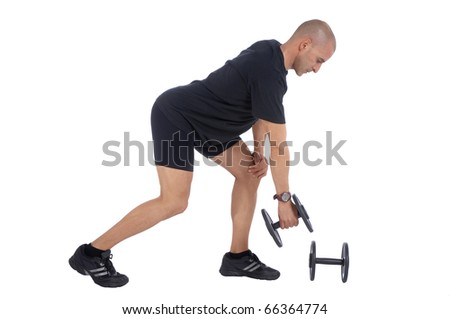 Personal fitness trainer (coach) exercising with dumbells over white background - stock photo