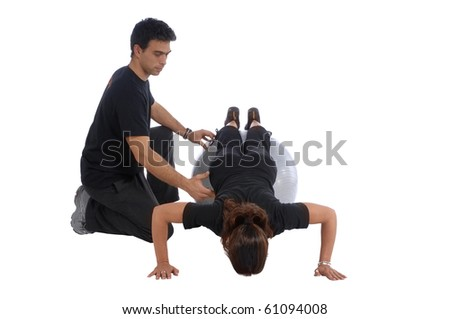 Personal Fitness trainer with girl exercising in gym - stock photo