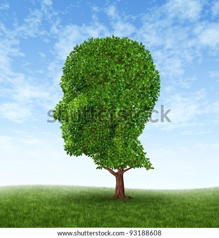 Personal growth and personality development as a medical symbol of psychology as a tree in the shape of a human head and brain as intelligence and social thinking for mental behavior health. - stock photo