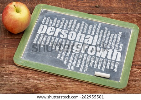 personal growth word cloud on a slate blackboard with apple - stock photo