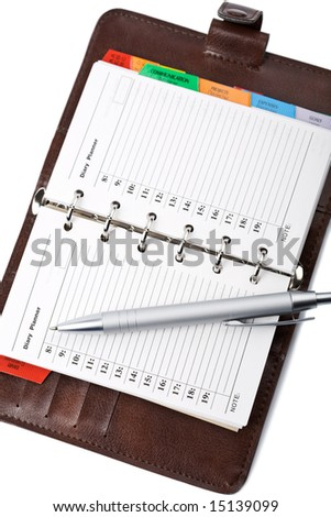 personal leather organizer and pen isolated - stock photo