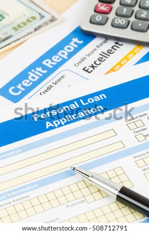 Personal loan application form excellent credit score with calculator, dollar money, and pen