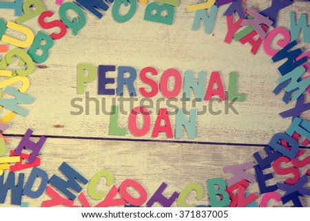 personal loan word block concept photo on plank wood - stock photo