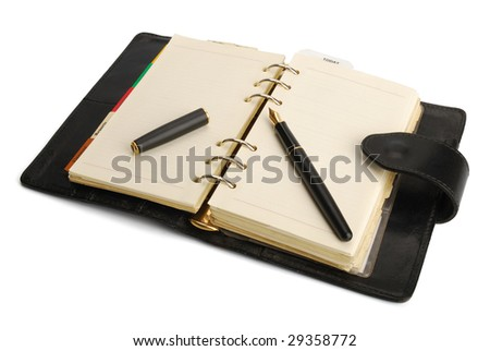 Personal organizer and a fountain pen isolated on white, with clipping path. - stock photo
