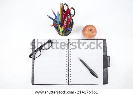 Personal organizer and stationery, isolated on white background - stock photo