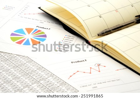 Personal organizer on business chart - stock photo