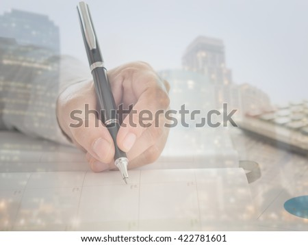 Personal organizer or planner on notebooks with view city at night in background - stock photo