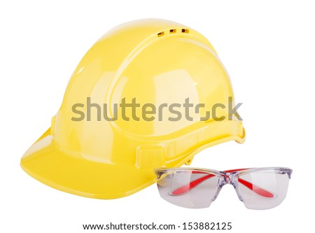 Personal safety equipment or PPE - personal protective equipment - with a hard hat and safety glasses isolated on white - stock photo