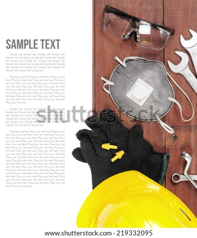 personal safety equipments on wooden plank - stock photo
