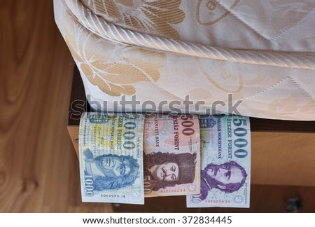 Personal savings, hungarian money, under the bed mattress - stock photo