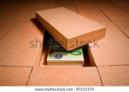 personal savings under a brick in the floor - stock photo