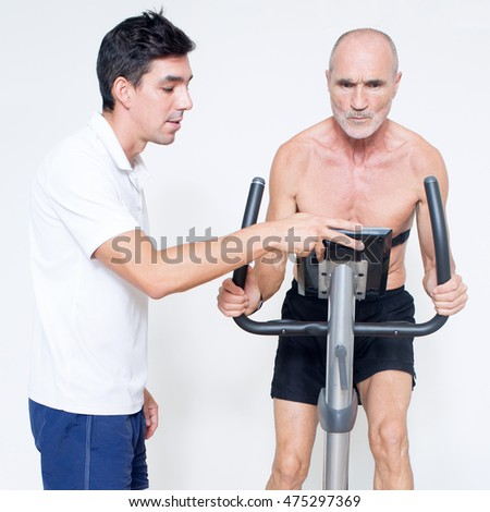 Personal trainer helping with heart rate test