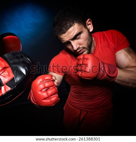 personal trainer man coach and man exercising boxing in the gym - stock photo
