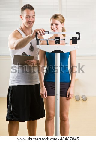 Personal training weight woman in health club - stock photo