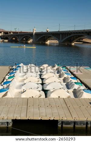 Personal Watercraft docked in marina at city park lake. - stock photo