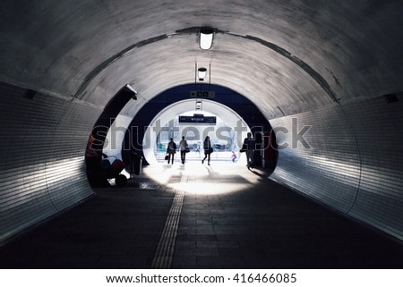 persons goes through an modern underpass - stock photo