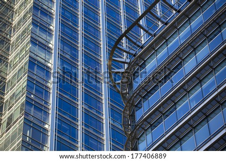 Perspective and underside angle view to textured background of modern glass building skyscrapers