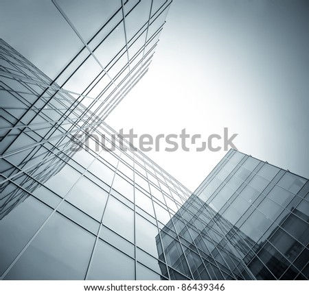 perspective angle view to dark high rise glass skyscrapers at night - stock photo