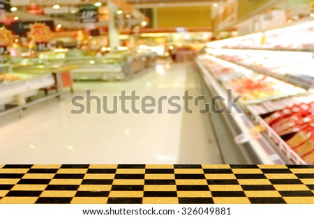 perspective chessboard floor with blur store background - stock photo