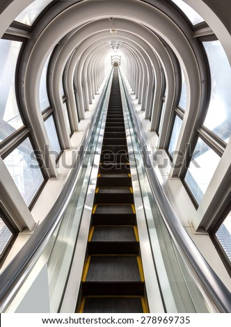 perspective escalators stairway inside contemporary blue glass business centre, concept of successful career elevation - stock photo