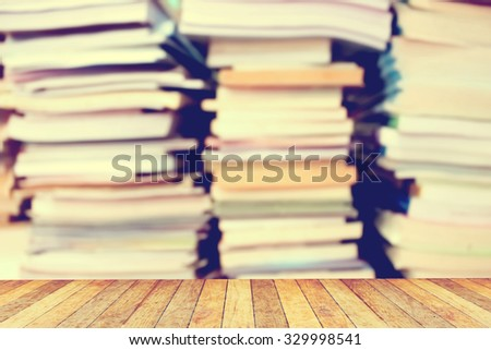 perspective floor on blur stacking book on the floor background ,vintage tone - stock photo