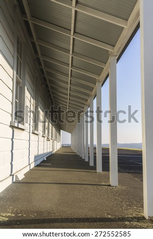 Perspective of a porch on an old army barracks