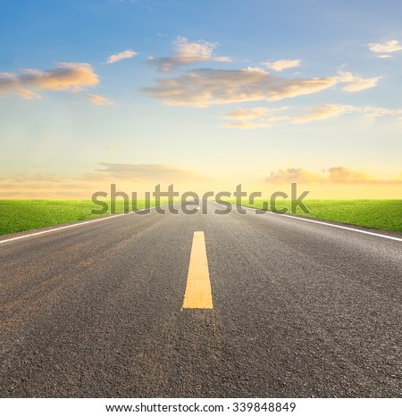 Perspective of asphalt road with blue sky. - stock photo