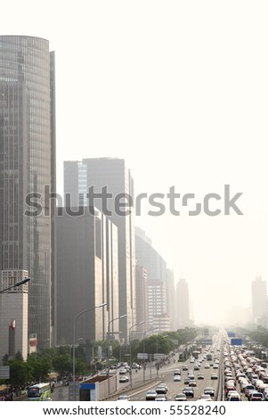 Perspective of avenue in haze at evening, Beijing, China - stock photo