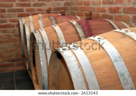 Perspective of barrels in a cellar - stock photo