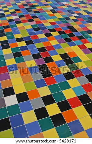 perspective of colorful mosaic tiles pattern on a wall - stock photo