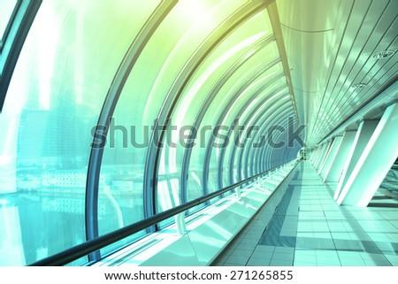 Perspective of long futuristic corridor - stock photo