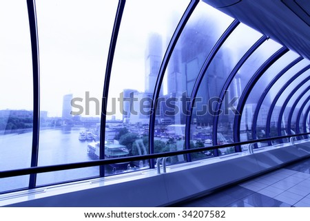 Perspective of the corridor and skyscrapers beyond window - stock photo