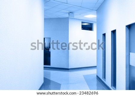 Perspective of the corridor at modern office toned in blue color