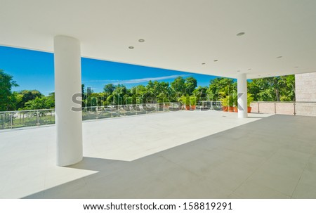 Perspective of the modern glass and steel balcony, deck and plaza railing. Exterior, interior design. - stock photo