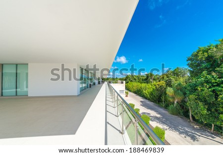 Perspective of the modern glass and steel balcony, deck, patio, promenade railing. Exterior, interior design. - stock photo