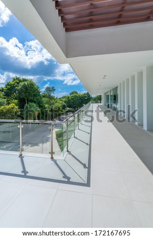 Perspective of the modern glass and steel balcony, deck, patio railing. Exterior, interior design. - stock photo