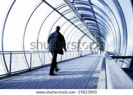 Perspective of the passage and man in motion blur