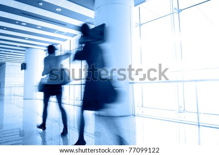 Perspective of the passage and people in motion blur - stock photo